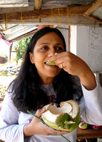 Eating young coconut at a roadside stand